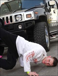 Leslie Winston, sick of the event, throws himself under a passing royal Humvee.